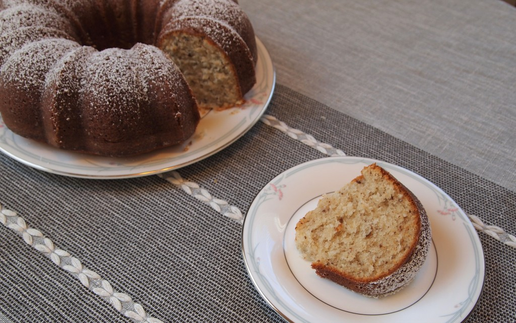 a black walnut bundt cake, with one slice cut out
