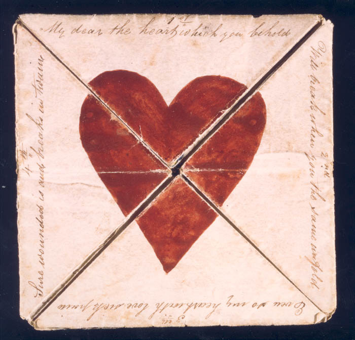 Folded Valentine Card with a red heart in center. Text around outside reads'My Dear the heart which you behold/ Will break when you the same unfold/ Even so my heart with love sick pain/ Sure wounded is and breaks in twain'