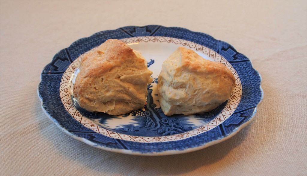 2 scones on a blue and white plate.